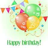 Birthday card with three balloons and pennants over light green Royalty Free Stock Photography