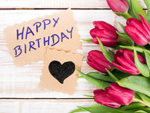 Birthday card and tulip bouquet Royalty Free Stock Photos