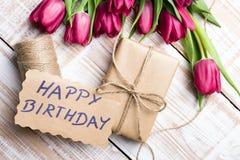 Birthday card and tulip bouquet Stock Photos