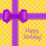 Birthday card with violet ribbons and bow on yellow dotted backg Stock Images