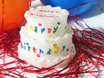 Birthday Celebration. Birthday cake, balloons and red streamers stock photo