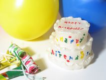 Birthday Celebration. Birthday cake, balloons and noise makers royalty free stock image