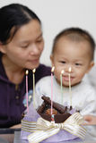 Birthday celebration. A birthday celebration in Chinese family, the mother and her baby are so sweet Royalty Free Stock Photography
