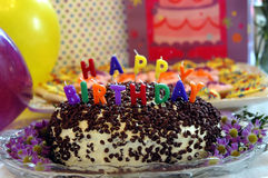 Birthday Celebration. Birthday cake, presents, balloons and cupcakes royalty free stock photos