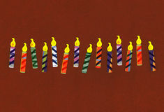 Birthday Celebration Candles. Isolated on dark brown background Stock Photos