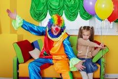Birthday celebration with clown. Royalty Free Stock Photos