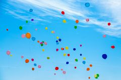 Many colorful balloons flying in the sky. Birthday, celebration, festival, wedding, childhood, hope and anniversary concept - many colorful balloons flying in royalty free stock photos