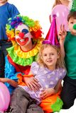Birthday child clown playing with children. Kid holiday cakes celebratory. Royalty Free Stock Image