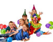 Birthday child clown playing with children. Kid cakes celebratory. Birthday child clown playing with children. Fun of group people lying floor on white Stock Photos