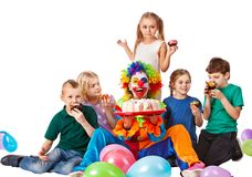 Birthday child clown playing with children. Kid cakes celebratory. Royalty Free Stock Photo