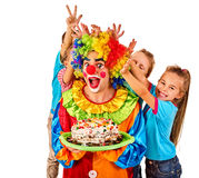 Birthday child clown playing with children. Kid cakes celebratory. Stock Photos