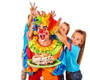 Birthday child clown playing with children. Kid cakes celebratory. Birthday child clown playing with children. Kid cakes celebratory in hands of events Stock Photos