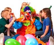 Birthday child clown playing with children. Kid cakes celebratory. Birthday child clown playing with children. Kid cakes celebratory in hands of events Stock Photo