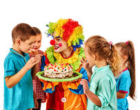 Birthday child clown playing with children. Kid cakes celebratory. Birthday child clown playing with children. Kid cakes celebratory in hands of events Royalty Free Stock Photography