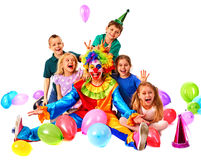 Birthday child clown playing with children. Kid cakes celebratory. Birthday child clown playing with children. Kid holiday cakes celebratory in hands of events Royalty Free Stock Image