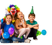 Birthday child clown playing with children. Kid holiday balloons celebratory. Stock Image