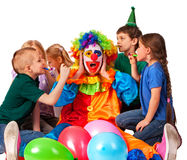 Birthday child clown playing with children. Kid holiday cakes celebratory. Birthday child clown playing with children and bunny fingers prank. Kid holiday cakes Stock Image