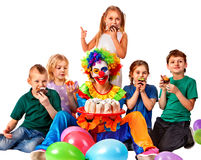 Birthday child clown playing with children. Kid holiday cakes celebratory. Birthday child clown playing with children and bunny fingers prank. Kid holiday cakes Stock Photo