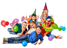 Birthday child clown playing with children. Kid holiday cakes celebratory. Birthday child clown playing with children and bunny fingers prank. Kid holiday cakes Stock Photography