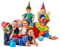 Birthday child clown playing with children. Kid holiday cakes celebratory. Birthday child clown playing with children and bunny fingers prank. Kid holiday cakes Royalty Free Stock Images