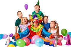 Birthday child clown playing with children. Kid holiday cakes celebratory. Birthday child clown playing with children and bunny fingers prank. Kid celebrate royalty free stock image