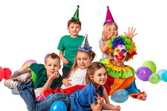 Birthday child clown playing with children. Kid holiday cakes celebratory. Birthday child clown playing with children and bunny fingers prank. Kid posing for stock image