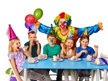 Birthday child clown playing with children. Kid holiday cakes celebratory. Birthday child clown playing with children who eat cake. Fun of group people pose for royalty free stock images