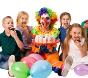 Birthday child clown playing with children. Kid holiday cakes celebratory. Birthday child clown playing with children who eat cake. Kid with nose bunny fingers stock images