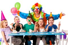 Birthday child clown playing with children. Kid holiday cakes celebratory. Birthday child clown playing with children who eat cake. Kid with nose bunny fingers royalty free stock photos