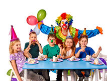 Birthday child clown playing with children. Kid holiday cakes celebratory. Birthday child clown playing with children who eat cake. Kid with nose bunny fingers Royalty Free Stock Image