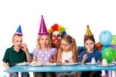 Birthday child clown playing with children. Kid holiday cakes celebratory. Birthday child clown playing with children who eat cake. Kid with nose bunny fun of stock photo