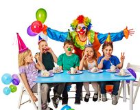 Birthday child clown playing with children. Kid holiday cakes celebratory. Stock Image