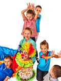 Birthday child clown playing with children. Kids give someone bunny ears. Birthday child clown playing with children. Kid holiday cakes celebratory in hands of Royalty Free Stock Photos