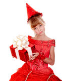 Birthday child girl  in red dress with gift box. Stock Image