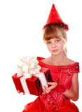 Birthday child girl in red dress with gift box. Stock Photo