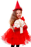 Birthday child in red dress with gift box. Stock Photography