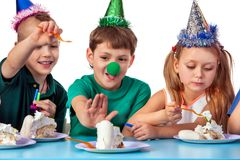 Birthday children celebrate party and eating cake on plate together. Stock Photo