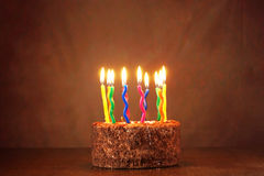 Birthday chocolate cake with a lot of burning candles Royalty Free Stock Image