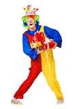 Birthday clown holding gift boxes Stock Photos
