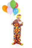 Birthday Clown Isolated. Happy birthday clown holding a bunch of balloons. Full body isolated stock photos