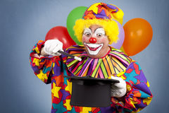 Birthday Clown Magic Show. Birthday clown with a top hat and wand, putting on a magic show royalty free stock photography