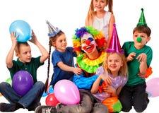 Birthday clown playing children. Kid wearing party hat hold balloons . Birthday child clown playing with children . Kid wearing party hat hold balloons happiest stock photos
