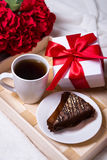 Birthday concept - close up of breakfast with cake, tea and litt Royalty Free Stock Photo