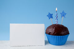Empty birthday card stock photos download 12719 images birthday concept with cupcake and candle next to empty greeting card on blue background birthday bookmarktalkfo Choice Image
