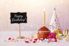 Birthday concept with cupcake and candle next to little chalkboa Royalty Free Stock Image