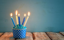 Birthday concept with cupcake and candles on wooden table. Stock Photos