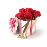 Birthday concept with red roses in gift isolated on white background  Royalty Free Stock Images