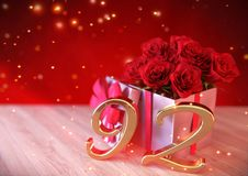 Birthday concept with red roses in gift on wooden desk.  Royalty Free Stock Photo