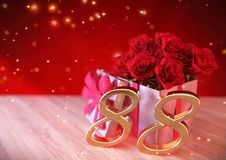 Birthday concept with red roses in gift on wooden desk. eighty-eighth. 88th. 3D render Royalty Free Stock Photo
