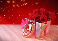 Birthday concept with red roses in gift on wooden desk.  Stock Image